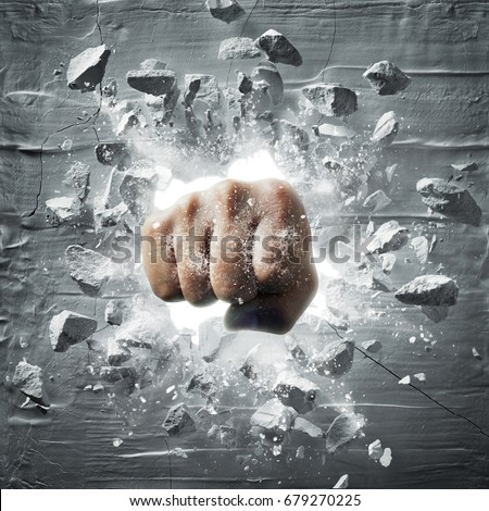 fist punching out from wall with debris