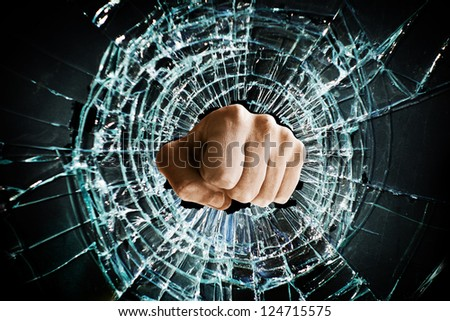 Fist punching thru a glass window