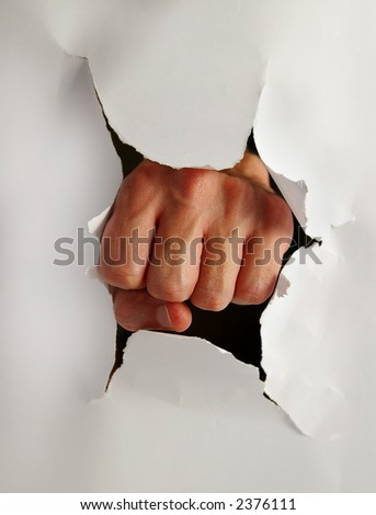 Fist punching thru paper creating a torn hole