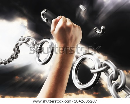 Fist smashes the fetters. Chains in the form of procent sign. Concept freedom from the chains of slavery.