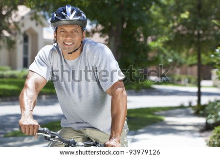 Fit & Healthy African American man riding a bicycle in the summer. - stock photo