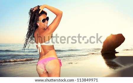 Fit beautiful woman in tropical beach at sunset