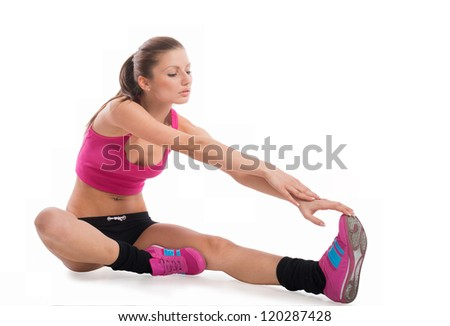 Fit girl stretching her leg, on white background  ,