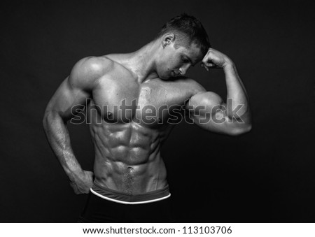 Fit male model showing his biceps