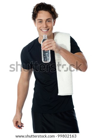 Fit man drinking water with towel on his shoulders isolated on white