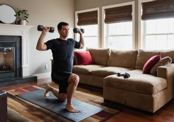 Fit man exercising at home with hand weights in his living room.
