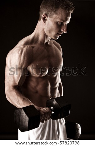 Fit man flexing his muscles
