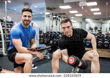 Fit man working out in weights room at the gym