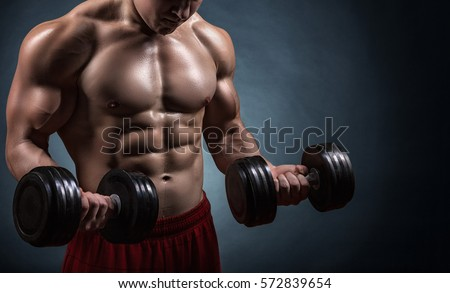 Fit muscular man exercising with dumbbell on dark background