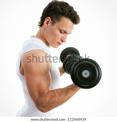 Fit muscular man exercising with dumbbell on white background