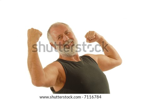 Fit older man showing off the muscles he's kept throughout his life; isolated on white