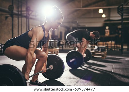 Fit people are going to do deadlift. Horizontal indoors shot #699574477