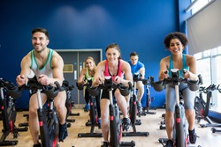 Fit people in a spin class the gym