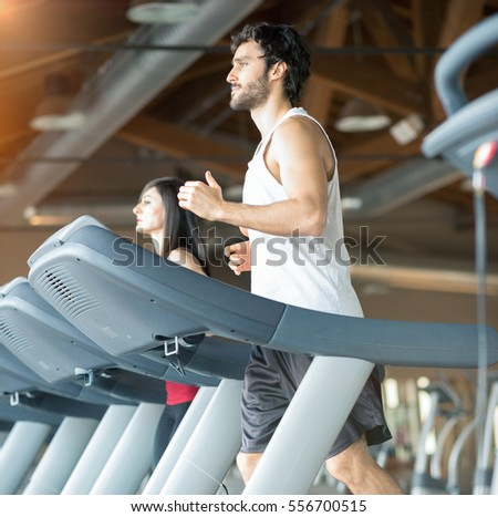 Fit people working out in a gym