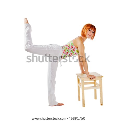 Fit red woman performing fitness exercises with a stool isolated on white background - stock photo