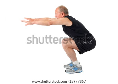 Fit senior man doing a squat