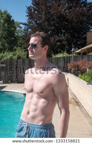 Healthy fit man sitting by the pool… Stock Photo 1183619629 - Avopix com