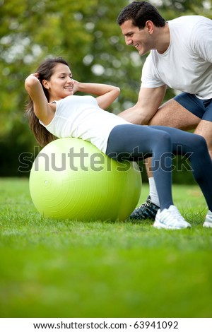Fit woman and her sports trainer exercising outdoors