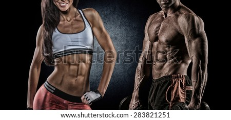 Fit woman and man showing her perfect abs