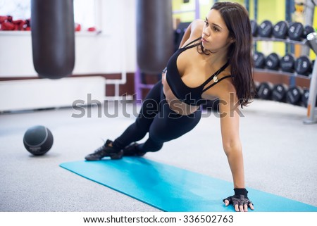 Fit woman doing side plank yoga pose Concept pilates fitness healthy lifestyle.