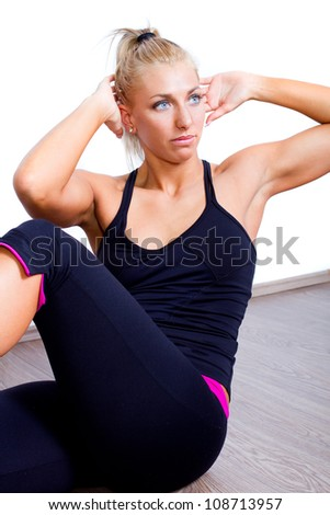fit woman doing sit-ups exercise abdominal workout isolated on white