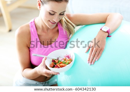 Shutterstock Fit woman eating healthy salad after workout