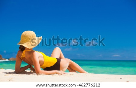 Fit woman in sun hat and bikini at beach.remote tropical beaches and countries. travel concept #462776212