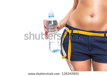 Fit woman refreshing after workout - stock photo