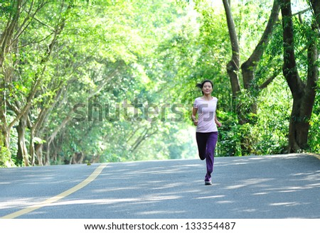 fit woman runner running