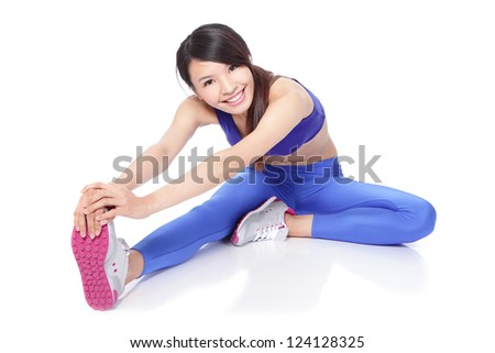 Fit woman stretching her leg to warm up - isolated over white background, asian model