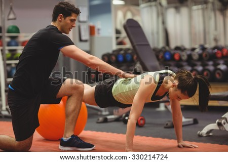 fit woman working out with...