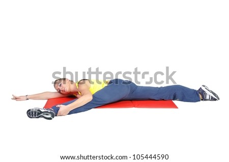 Fit young female yoga instructor showing different exercises on a white background