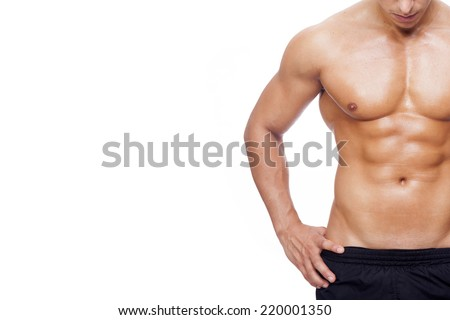 Fit young man with beautiful torso, isolated on white background