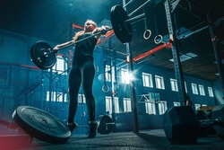 Fit young woman lifting barbells working out at a gym. Sport, fitness, weightlifting, bodybuilding, training, athlete, workout exercises concept