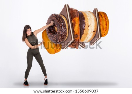 Fit young woman saying NO to sweets and candy, Fit young woman saying NO to unhealthy carbohydrates