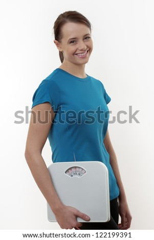 Fit young woman with holding scales