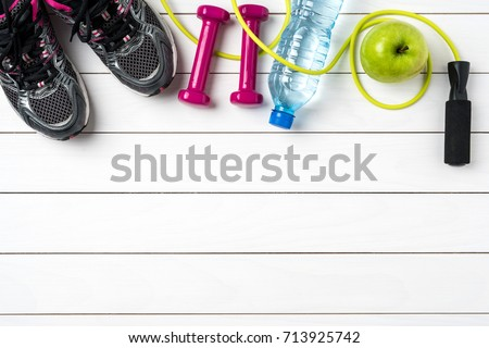 Fitness accessories on white wooden table