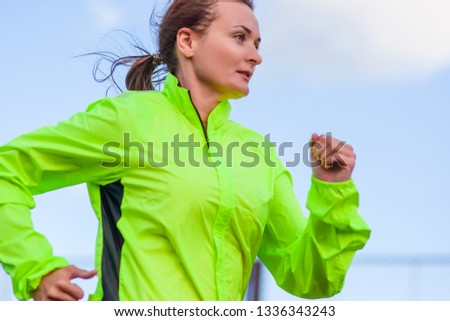 Fitness and Healthy Lifestyle Concepts. Female Athlete Having Running Exercise Outdoors. Horizontal Image