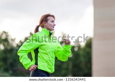 Fitness and Healthy Lifestyle Concepts. Female Athlete Having Running Exercise Outdoors. Horizontal Image Composition