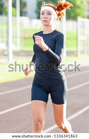 Fitness and Healthy Lifestyle Concepts. Female Athlete Having Running Exercise Outdoors. Vertical Image Composition