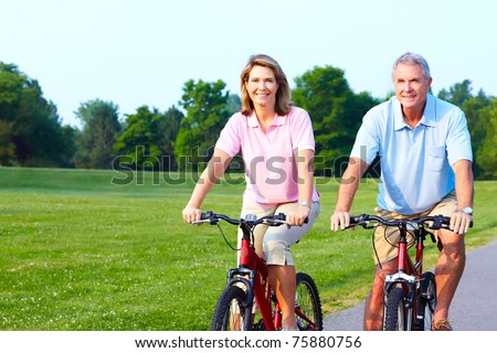 Fitness and healthy lifestyle. Senior couple riding in the park.