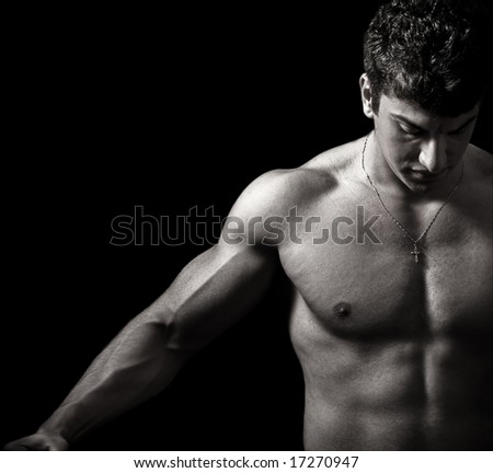 Fitness and Muscles. Muscular Man in the Dark