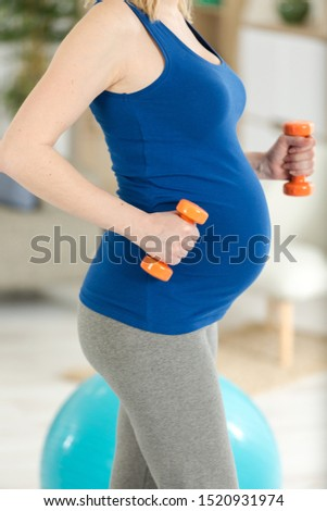 fitness and yoga exercises with dumbbels for pregnant woman