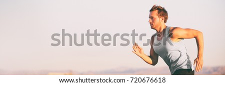 Fitness athlete runner man running on sunset sky background. Jogging active lifestyle concept.