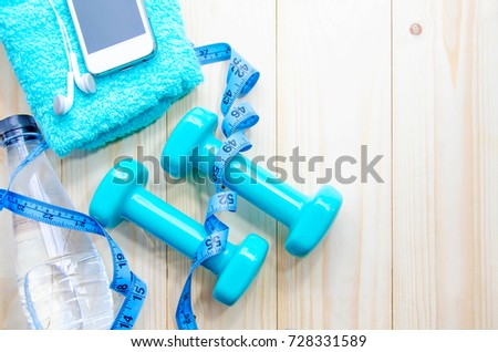 Fitness, Bottle of water and dumbbells on wood background for healthy concept. copy space for text. Top view #728331589