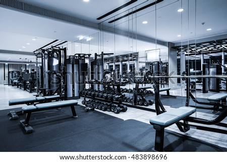 Fitness club in luxury hotel interior gym concept as background
