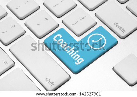 Fitness concept: Coaching key on the computer keyboard