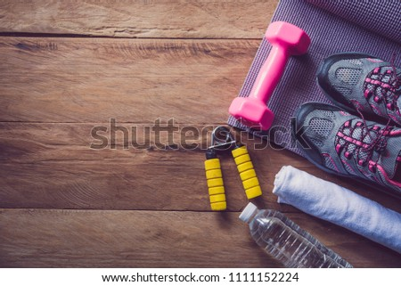 fitness concept with Exercise Equipment on wooden background. #1111152224