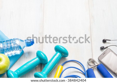 Fitness diet and healthy lifestyle concept background with sport gear