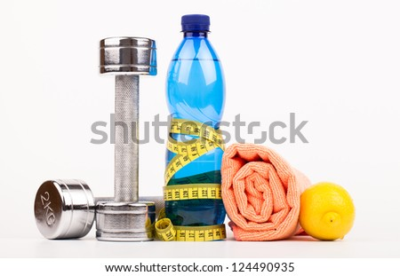 fitness dumbbells water and fruits  isolated on white